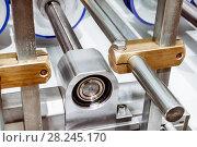 Купить «Bearing assembly of the roller conveyor.», фото № 28245170, снято 24 октября 2016 г. (c) Андрей Радченко / Фотобанк Лори
