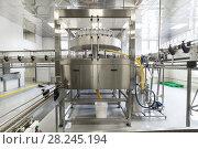Купить «Factory for bottling alcoholic beverages», фото № 28245194, снято 5 июля 2017 г. (c) Андрей Радченко / Фотобанк Лори