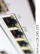 Купить «Network switch front panel», фото № 28245210, снято 9 декабря 2016 г. (c) Андрей Радченко / Фотобанк Лори