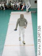 Купить «Teenager young fencer in white costume and protective mask», фото № 28247526, снято 26 марта 2018 г. (c) Константин Шишкин / Фотобанк Лори