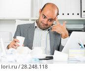 Купить «Busy businessman in shirt worrying at the computer», фото № 28248118, снято 3 мая 2017 г. (c) Яков Филимонов / Фотобанк Лори