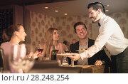 Купить «waiter bringing ordered dishes to guests», фото № 28248254, снято 8 января 2018 г. (c) Яков Филимонов / Фотобанк Лори