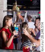 Купить «girl and male clubbing with cocktail», фото № 28248514, снято 28 августа 2017 г. (c) Яков Филимонов / Фотобанк Лори