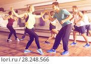 Купить «People learning swing at dance class», фото № 28248566, снято 24 октября 2018 г. (c) Яков Филимонов / Фотобанк Лори