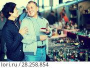 Купить «vigorous mature spouses buying retro handicrafts on flea market», фото № 28258854, снято 23 октября 2017 г. (c) Яков Филимонов / Фотобанк Лори