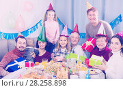 Купить «Happy family members having celebration», фото № 28258898, снято 25 мая 2018 г. (c) Яков Филимонов / Фотобанк Лори