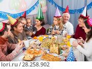 Купить «Family members are happy to celebrate children's birthday», фото № 28258902, снято 25 мая 2018 г. (c) Яков Филимонов / Фотобанк Лори