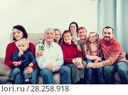 Купить «Family members making family photo», фото № 28258918, снято 25 мая 2018 г. (c) Яков Филимонов / Фотобанк Лори