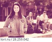 Portrait of teenager girl standing aside from friends outdoors. Стоковое фото, фотограф Яков Филимонов / Фотобанк Лори