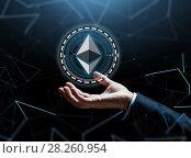Купить «businessman hand with ethereum over binary code», фото № 28260954, снято 6 сентября 2016 г. (c) Syda Productions / Фотобанк Лори