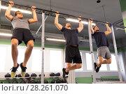 Купить «group of young men doing pull-ups in gym», фото № 28261070, снято 19 февраля 2017 г. (c) Syda Productions / Фотобанк Лори