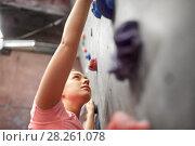 Купить «young woman exercising at indoor climbing gym», фото № 28261078, снято 2 марта 2017 г. (c) Syda Productions / Фотобанк Лори