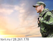 Купить «soldier in military uniform with backpack hiking», фото № 28261178, снято 14 августа 2014 г. (c) Syda Productions / Фотобанк Лори