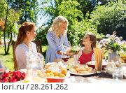 Купить «happy family having dinner at summer garden», фото № 28261262, снято 9 июля 2017 г. (c) Syda Productions / Фотобанк Лори