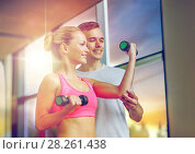 Купить «smiling young woman with personal trainer in gym», фото № 28261438, снято 29 июня 2014 г. (c) Syda Productions / Фотобанк Лори