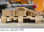 Купить «wooden boards or fibreboards at woodworking plant», фото № 28261478, снято 10 ноября 2017 г. (c) Syda Productions / Фотобанк Лори