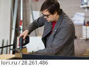 Купить «assembler with screwdriver making furniture», фото № 28261486, снято 10 ноября 2017 г. (c) Syda Productions / Фотобанк Лори