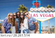 Купить «friends travelling to las vegas and taking selfie», фото № 28261514, снято 27 августа 2015 г. (c) Syda Productions / Фотобанк Лори