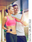 Купить «smiling young woman with personal trainer in gym», фото № 28261522, снято 29 июня 2014 г. (c) Syda Productions / Фотобанк Лори