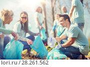 Купить «volunteers with garbage bags cleaning park area», фото № 28261562, снято 7 мая 2016 г. (c) Syda Productions / Фотобанк Лори