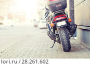 Купить «close up of motorcycle parked on city street», фото № 28261602, снято 12 мая 2016 г. (c) Syda Productions / Фотобанк Лори