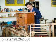 Купить «Restorer of furniture in workroom», фото № 28262050, снято 8 апреля 2017 г. (c) Яков Филимонов / Фотобанк Лори
