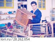 Купить «Restorer of furniture in workroom», фото № 28262054, снято 8 апреля 2017 г. (c) Яков Филимонов / Фотобанк Лори