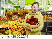 Купить «girl with big red apples in hands in fruit market», фото № 28262246, снято 13 февраля 2018 г. (c) Яков Филимонов / Фотобанк Лори