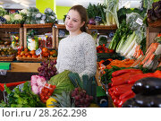 Купить «Happy girl among fruits and vegetables on store shelves», фото № 28262298, снято 13 февраля 2018 г. (c) Яков Филимонов / Фотобанк Лори