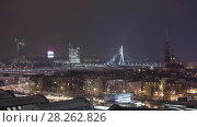 Купить «Night Riga city winter timelapse, lights, bridge, Daugava river», видеоролик № 28262826, снято 1 декабря 2017 г. (c) Aleksejs Bergmanis / Фотобанк Лори