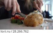 Купить «Close up woman eating dinner in cafe», видеоролик № 28266762, снято 6 апреля 2018 г. (c) Ekaterina Demidova / Фотобанк Лори