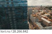 Купить «Aerial footage of modern business center in the middle of the old town», видеоролик № 28266842, снято 6 апреля 2018 г. (c) Ярослав Ковальчук / Фотобанк Лори