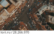 Купить «Top down aerial view of intersection with a lot of cars», видеоролик № 28266970, снято 6 апреля 2018 г. (c) Ярослав Ковальчук / Фотобанк Лори