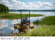 Купить «Очистка дна озера земснарядом», фото № 28267210, снято 9 августа 2017 г. (c) Pukhov K / Фотобанк Лори
