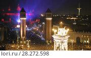 Купить «New Year celebrations with city lights at Placa Espana in Barcelona», видеоролик № 28272598, снято 6 января 2017 г. (c) Яков Филимонов / Фотобанк Лори