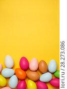 Купить «Colorful Easter eggs on a yellow background», фото № 28273086, снято 17 марта 2018 г. (c) Иван Карпов / Фотобанк Лори