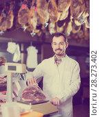 Купить «male seller weighing piece of meat in butcher's shop», фото № 28273402, снято 2 января 2017 г. (c) Яков Филимонов / Фотобанк Лори