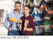 Купить «Man and woman with brushes and roller for repair», фото № 28273410, снято 16 февраля 2018 г. (c) Яков Филимонов / Фотобанк Лори