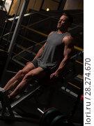Купить «Strong man in t-shirt and shorts doing exercises», фото № 28274670, снято 10 февраля 2018 г. (c) Pavel Biryukov / Фотобанк Лори