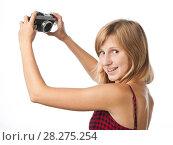 Купить «Девушка фотографирует сама себя на компактный фотоаппарат», эксклюзивное фото № 28275254, снято 12 сентября 2010 г. (c) Давид Мзареулян / Фотобанк Лори