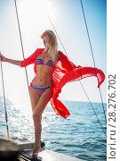 Beautiful bikini girl in open water sea on yacht. Стоковое фото, фотограф katalinks / Фотобанк Лори