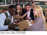 Купить «Friends choosing dishes from restaurant menu», фото № 28276930, снято 7 марта 2018 г. (c) Яков Филимонов / Фотобанк Лори