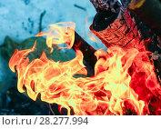 Купить «Flames on blue background», фото № 28277994, снято 9 марта 2018 г. (c) Алексей Маринченко / Фотобанк Лори