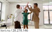 Купить «happy creative team making high five at office», видеоролик № 28278146, снято 18 марта 2018 г. (c) Syda Productions / Фотобанк Лори