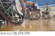 Купить «Handicapped basketball player in a wheelchair during sportive training», фото № 28279378, снято 6 декабря 2019 г. (c) Константин Шишкин / Фотобанк Лори