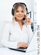 Купить «Young girl in call center with headphones sitting with laptop», фото № 28280154, снято 17 октября 2017 г. (c) Яков Филимонов / Фотобанк Лори