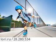 Купить «Boy in roller blades doing tricks at skate park», фото № 28280534, снято 14 октября 2017 г. (c) Сергей Новиков / Фотобанк Лори