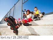 Купить «African girl resting after rollerblading outdoors», фото № 28280602, снято 14 октября 2017 г. (c) Сергей Новиков / Фотобанк Лори