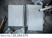 Купить «Crumpled pages and notebook», фото № 28284670, снято 25 апреля 2018 г. (c) Яков Филимонов / Фотобанк Лори