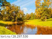 Купить «Autumn landscape. Autumn trees at the bank of the river in sunny day», фото № 28297530, снято 21 сентября 2017 г. (c) Зезелина Марина / Фотобанк Лори